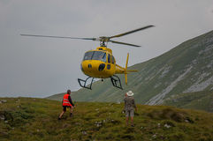 Helicopter in mountain rescue. Emergency Stock Photography