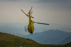 Helicopter in mountain rescue. Italy Royalty Free Stock Photo