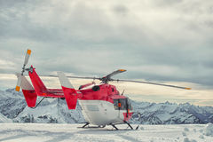 Helicopter mountain rescue service in the winter Stock Photo
