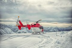 Helicopter mountain rescue service in the winter Stock Photography