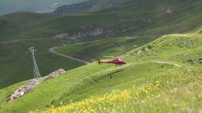 Helicopter in the mountains. Alpine peaks landskape background. Jungfrau, Bernese highland. Alps, tourism and adventure. Helicopter in the mountains. Alpine stock video footage