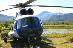 Helicopter with mountains behind it Stock Photo
