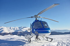 Helicopter in the mountains Royalty Free Stock Image