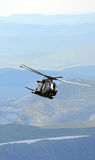 Helicopter in the Mountains Stock Photography