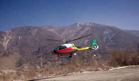 Helicopter in the mountains. Stock Photography