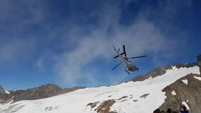 Helicopter in the mountains Stock Image
