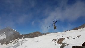 Helicopter in the mountains Stock Photos