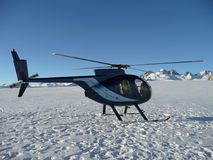 Helicopter on Mt Cook. Helicopter landing on top of Mt Cook in New Zealand Royalty Free Stock Photos