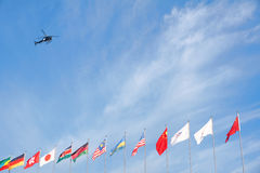 Helicopter and national flags stock photo