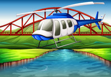 A helicopter near the bridge Royalty Free Stock Image