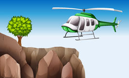 A helicopter near the cliff Royalty Free Stock Images