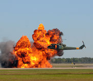 Helicopter near explosion. Helicopter hovering over giant explosion Royalty Free Stock Photos