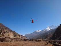Helicopter in Nepal. Rescue red helicopter flying in Himalayas, Nepal Stock Photography