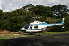 Helicopter,New Zealand. Helicopter in front of hill,The Bay of Islands,New Zealand Stock Photography