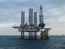 Helicopter and oil rig Stock Photos