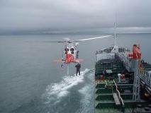 Helicopter and oil tanker Stock Photo