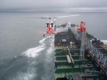 Helicopter and oil tanker Stock Images