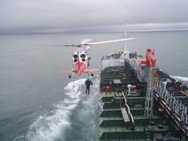 Helicopter and oil tanker Royalty Free Stock Photos