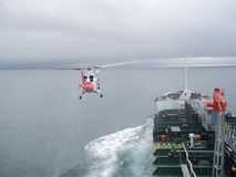 Helicopter and oil tanker Stock Photos