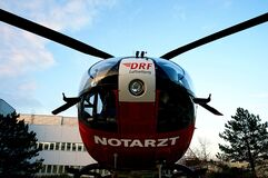 Helicopter outside hospital building