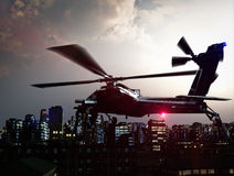 Helicopter over city Royalty Free Stock Photography