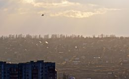 Helicopter over the city. Stock Photos
