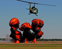 Helicopter over fire Stock Images