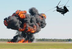 Helicopter over fire royalty free stock photos