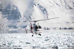 Helicopter over the frozen Arctic fjord Royalty Free Stock Photography