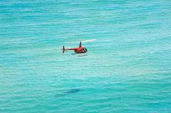Helicopter over the ocean Stock Images