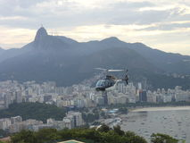 Helicopter over Rio. An helicopter flight over the city of Rio de Janeiro, Brazil, showing a landscape of beaches and buildings. There is a view of Christ the Royalty Free Stock Image