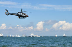 Helicopter over sea Royalty Free Stock Image