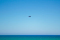 Helicopter over the sea Royalty Free Stock Photo