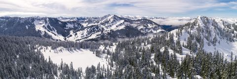 Helicopter Over Winter Mountian Sports Destination in Pacific No stock photo