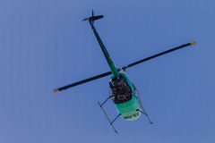 Helicopter Overhead  Blue  Stock Images