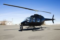 Helicopter parked at airport lot. Royalty Free Stock Images