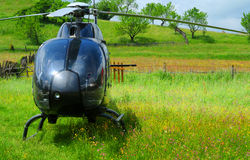 Helicopter parked on field stock photo