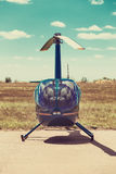 Helicopter parked at the helipad. All logos and text removed royalty free stock photos