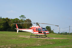 Helicopter parked at the helipad near forest Royalty Free Stock Photo
