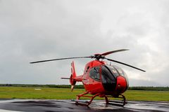 A helicopter. Parked on the tarmac green Stock Image
