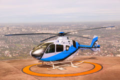 Helicopter parking on building roof top use for commercial air t Stock Photo