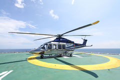 Helicopter parking landing on offshore platform. Helicopter transfer crews or passenger to work in offshore oil and gas industry Stock Photography