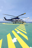 Helicopter parking landing on offshore platform. Helicopter transfer crews or passenger to work in offshore oil and gas industry Royalty Free Stock Images