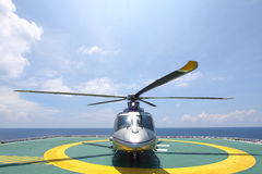 Helicopter parking landing on offshore platform. Helicopter transfer crews or passenger to work in offshore oil and gas industry Stock Photos