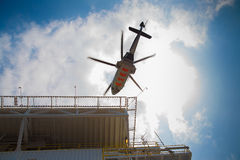 Helicopter parking at an offshore oil and gas platform to receive passenger and cargo to onshore. Helicopter parking at an offshore oil and gas platform to Stock Photography