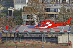 Helicopter and patient on the hospital roof of Thun City. THUN, SWITZERLAND - JANUARY 1, 2014: Helicopter and patient on the hospital roof of Thun City. Thun is Royalty Free Stock Photos
