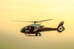 Helicopter. The patrol helicopter flying in the sky Royalty Free Stock Image