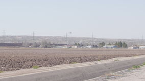 Helicopter Patrols Borderland of US and Mexico. Helicopter flies over fields as it patrols the borderland of US and Mexico stock footage