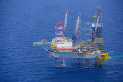 Helicopter pick up passenger on the offshore oil rig. Royalty Free Stock Photo