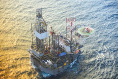 Helicopter pick up passenger on the offshore oil rig. Stock Image